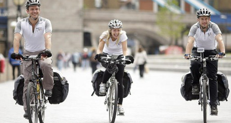Helmet cyclists on the streets of London. — AFP pic