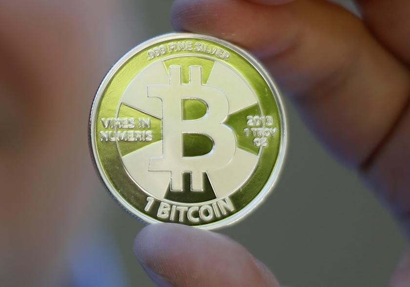 A mockup of a bitcoin, a virtual currency traded worldwide, is held in this photo illustration in Sandy, Utah in this September 17, 2013 file photo. — Reuters pic