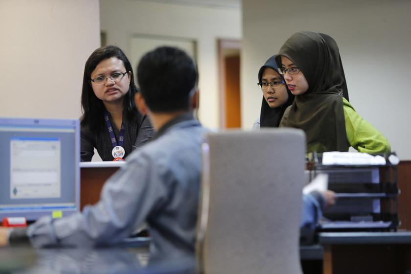 A panellist at a forum today said more initiatives are needed to encourage women to stay in the workforce. — Reuters pic