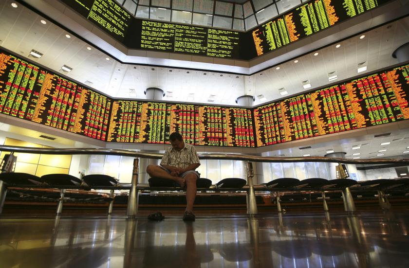 Bursa Malaysia eases on lack of buying support and global uncertainty at opening of trade.—Reuters pic