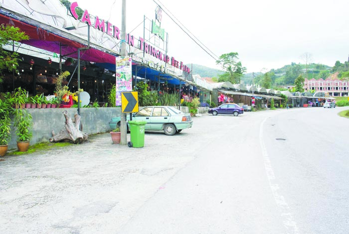 Business is down to a trickle at shops selling local products and souvenirs at Tringkap.