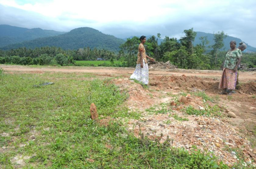 Locals looking around the site where candi number 11 once stood in Lembah Bujang, Kedah, December 2, 2013. — Picture by K.E. Ooi