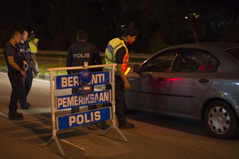 Police fired several shots at a car in Taman Tun Dr Ismail after its driver refused to stop at a road block early this morning. — AFP pic