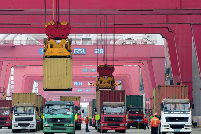 Exports from the world's second-largest economy are expected to have sunk 14 per cent in January-February from a year earlier, according to a median estimate from the survey of 25 economists, marking the steepest fall since February 2019. — AFP pic