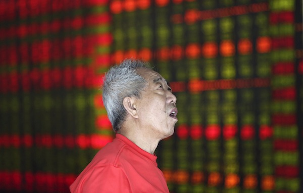 Asian markets initially fell after China reported a record slump in factory activity but the region rallied to finish higher. — Reuters pic