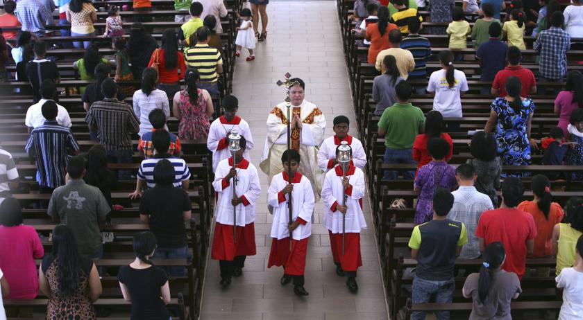 An NGO protested against the construction of a church in Petaling Jaya, claiming that it is part of an attempt to convert Muslims to Christianity. File picture shows a priest and altar boys during a mass service inside the Church of Our Lady of Lourdes in Klang. — Reuters pic