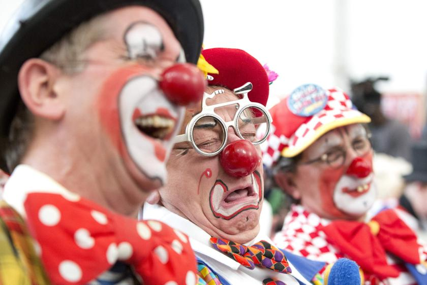 Clowns react during a church service in memory of Joseph Grimaldi at Holy Trinity Church in Dalston, east London February 2, 2014. — Reuters pic