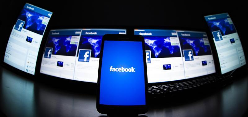 The loading screen of the Facebook application on a mobile phone is seen in this photo illustration taken in Lavigny May 16, 2012. — Reuters pic