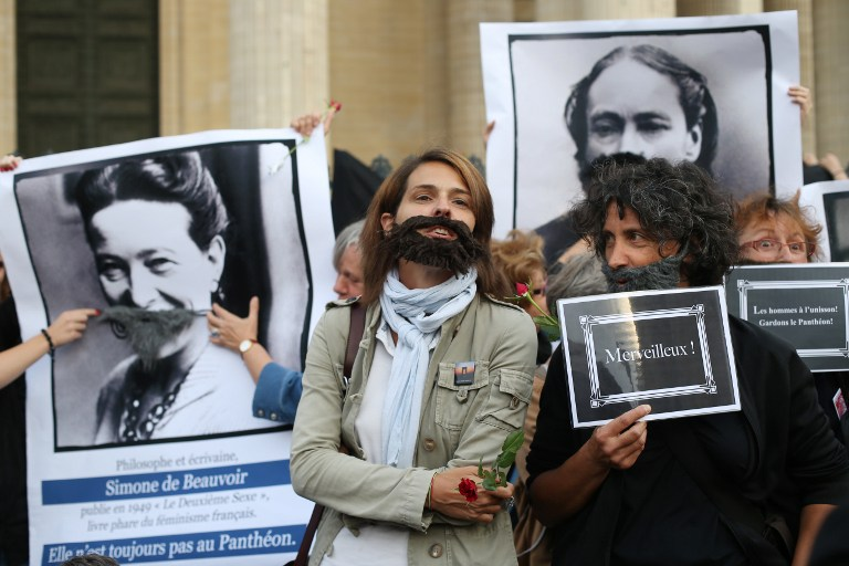 Feminist activists take part in a protest to ask for more women to be transferred in the French Pantheon monument honouring illustrious deceased people on August 26, 2013 in Paris. — AFP pic