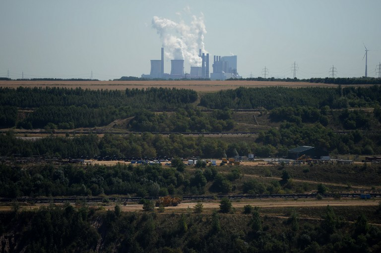 A power plant run by coal from the brown coal open cast mine Garzweiler is pictured on August 5, 2013 in Immigrath, western Germany. — AFP pic