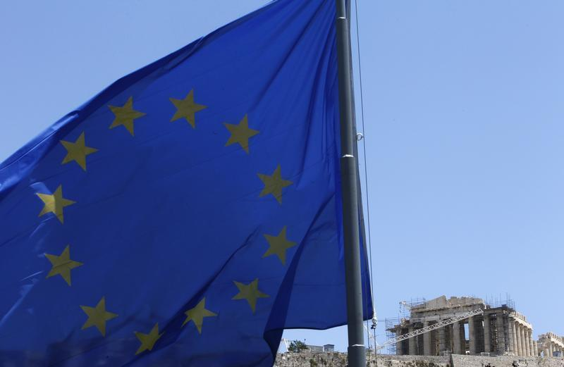 A European Union flag flutters in front of the monument of Parthenon on Acropolis hill in Athens June 17, 2012. — Reuters pic