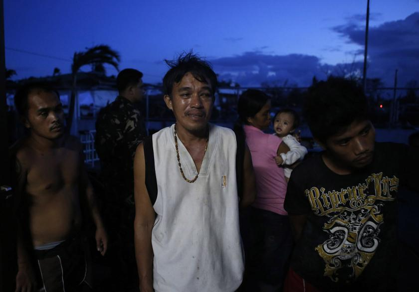 Survivors of super Typhoon Haiyan wait for medical assistance outside an airport in typhoon battered Tacloban city, in central Philippines November 9, 2013. —Reuters pic