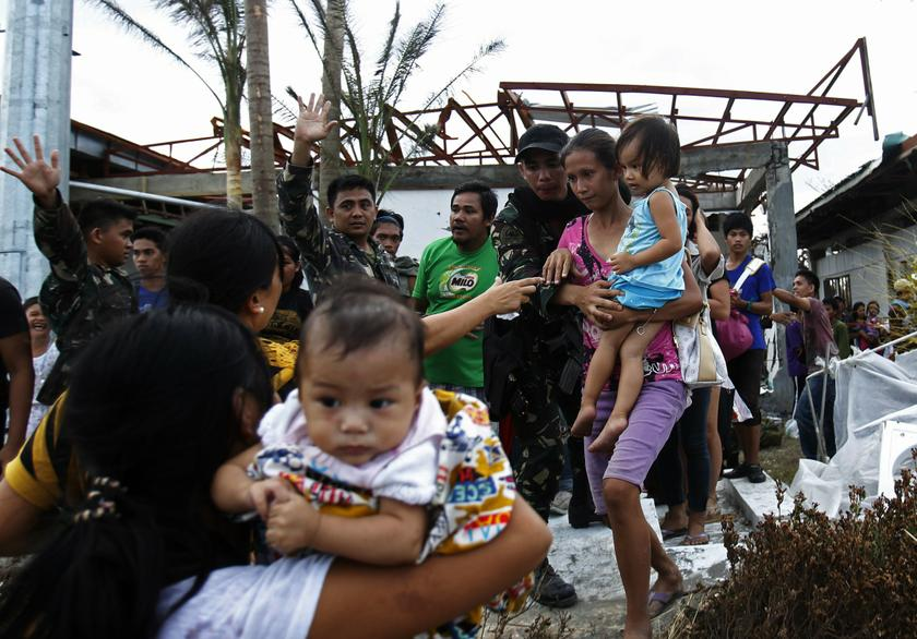 Soldiers help residents as they board a U.S. military C130 aircraft to leave for Manila after the Super typhoon Haiyan battered Tacloban city in central Philippines November 11, 2013. —Reuters pic