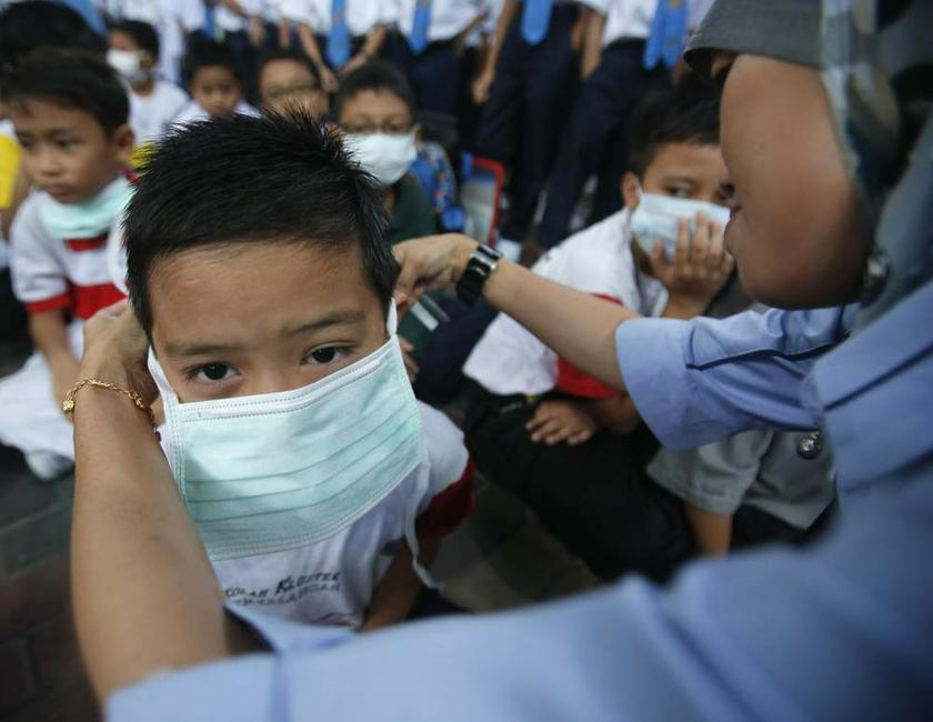 The Education Ministry encourages students, especially those experiencing colds and coughs to wear masks to avoid infecting other students. — Reuters pic