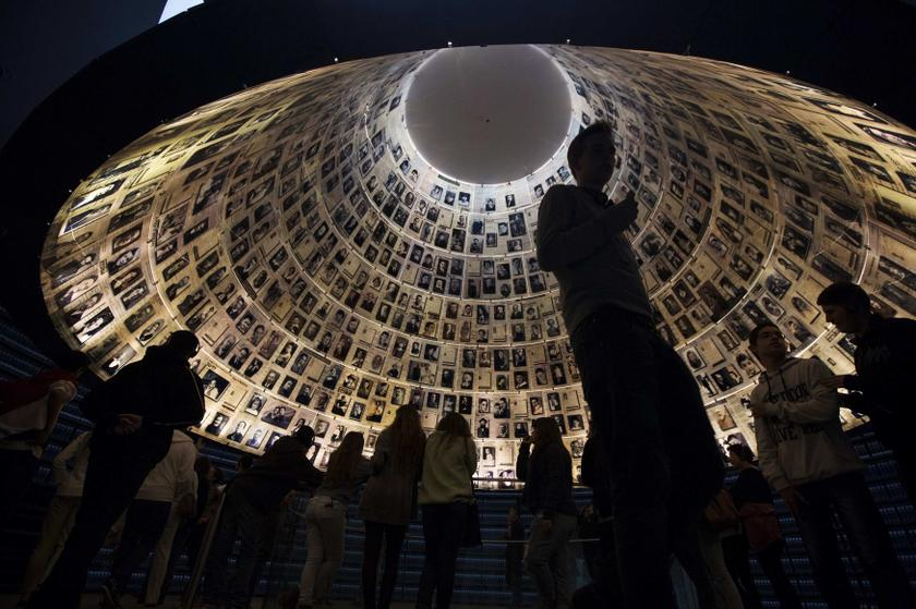 Visitors stand under pictures of Jews killed in the Holocaust in the Hall of Names at the Yad Vashem Holocaust History Museum in Jerusalem January 26, 2014. — Reuters pic