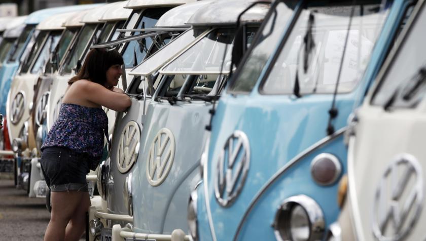 A visitor looks at Volkswagen Kombi minibus models during a Kombi fan club meeting in Sao Bernardo do Campo December 8, 2013. — Reuters pic
