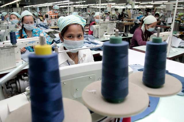 Big machine: Cambodia's garment sector employs more than 300,000 women and makes up 80% of the country's foreign exchange earnings. — Reuters pic