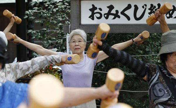 Staying fit: Japan's population has continually declined since 2007 by natural attrition. With more than 20 per cent of the population aged 65 or over, it has one of the highest proportions of elderly people in the world. — Reuters file pic
