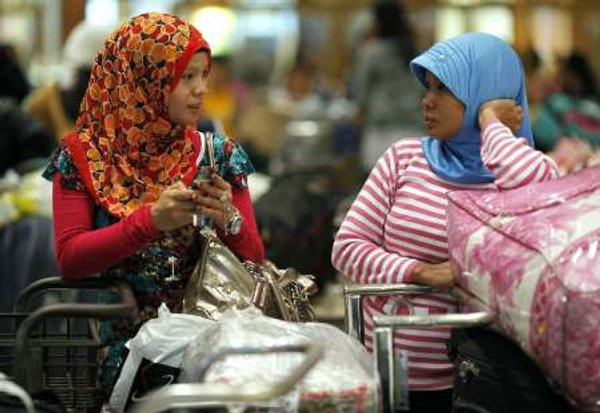 According to Nusron, 1.8 million of the 6.2 million Indonesians who are working abroad do not hold work permits, with the vast majority of the group mostly based in Malaysia. — Reuters pic
