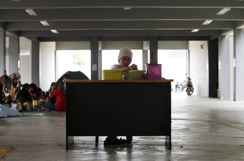 An evacuee eats inside a relief centre at Kemaman, 300km outside Kuala Lumpur December 6, 2013. — Reuters pic