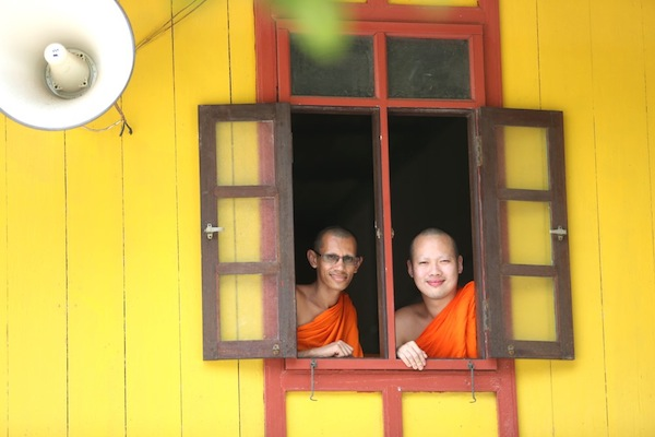 Kunmien and Chielyeasoon peering through the window of the chief abbot's residence. — Pictures by Choo Choy May