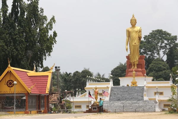 Wat Pikulthong in Kg Terbak, Tumpat is famed for its giant Standing Buddha statue.