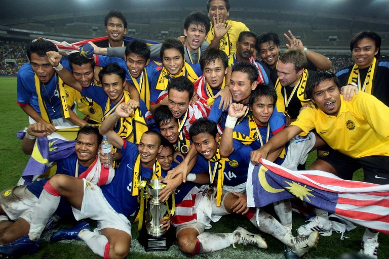 Malaysian footballers celebrate after their win over Myanmar in the final of The Merdeka Cup tournament in Shah Alam near Kuala Lumpur, 29 August 2007. – AFP pic