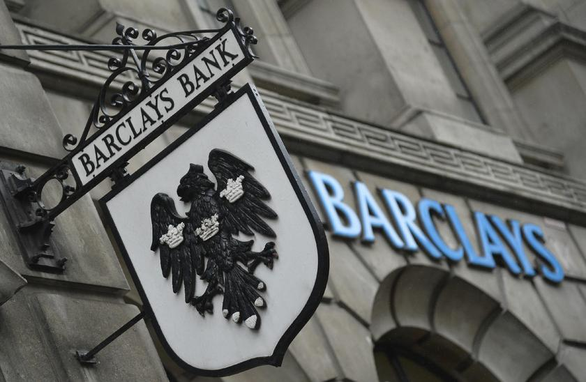 Logos are seen outside a branch of Barclays bank in London. — Reuters pic