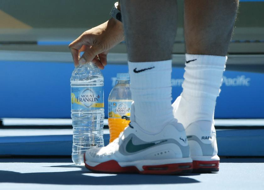 At every changeover, Rafael Nadal carefully spots his two bottles between his feet — one bottle of water next to an energy drink. — Reuters pic