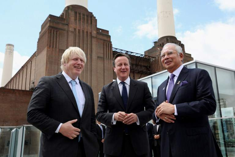 Prime Minister Datuk Seri Najib Razak with British Prime Minister David Cameron (centre) and London Mayor Boris Johnson (left) at Battersea Power Station in London on July 4, 2013. A Malaysia Square said to be inspired by Sarawak's Mulu Caves, will be placed at one of the entrances of this project. — AFP pic