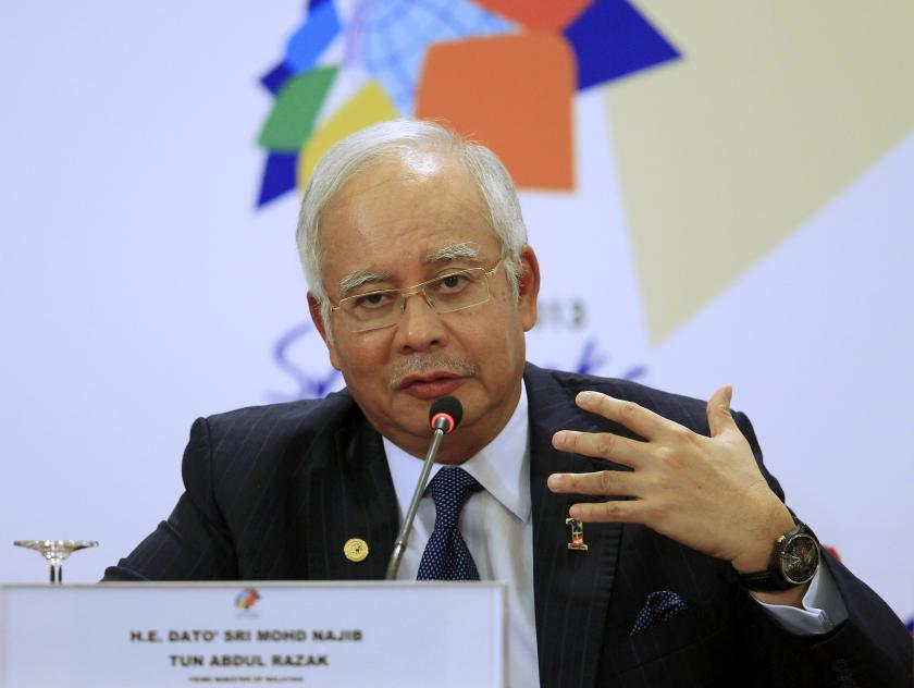 Prime Minister Datuk Seri Najib Razak gestures as he speaks during a news conference at the Commonwealth Heads of Government Meeting in this file picture taken on November 17, 2013. He has been given a report on the outcome of the Royal Commission of Inquiry on Illegal Immigrants in Sabah today.— Reuters pic