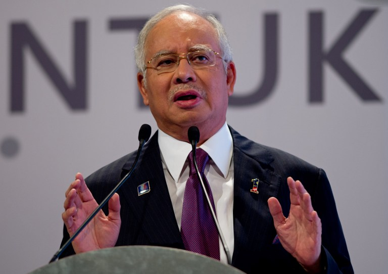 WSJ reported Friday that 1MDB investigators have discovered five separate deposits from two sources that were made into Prime Minister Datuk Seri Najib Razak's accounts. — AFP pic