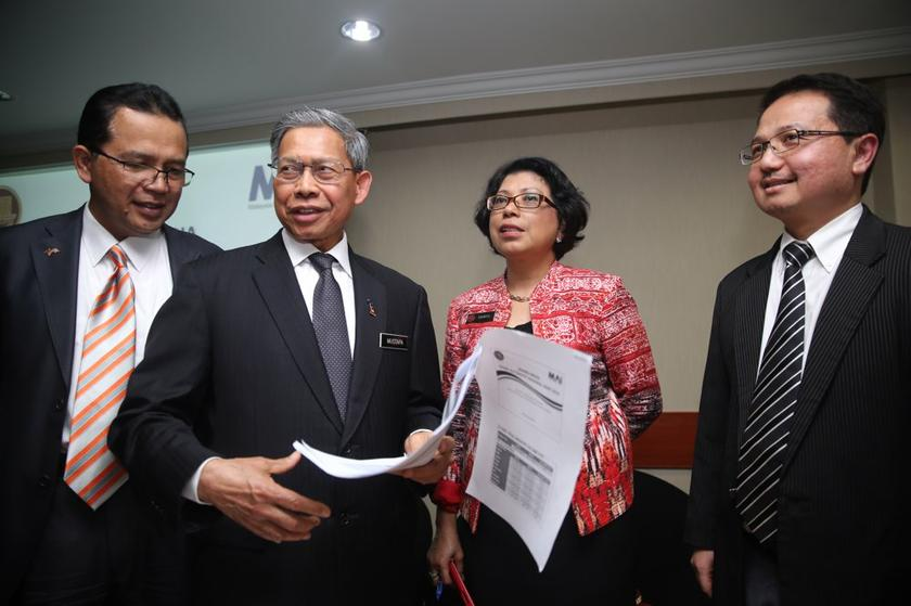 File photo shows Minister of International Trade and Industry, Datuk Seri Mustapa Mohamed (second left), at the unveiling of the National Automotive Policy (NAP) 2014 in Kuala Lumpur January 20, 2014. — Picture by Choo Choy May