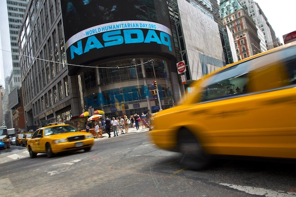 Taxi cabs drive past the Nasdaq MarketSite in New York's Times Square. — Reuters file pic