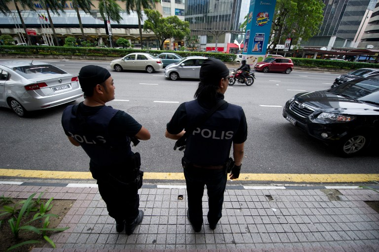 File picture of Malaysian special policemen standing guard in downtown Kuala Lumpur. — AFP pic
