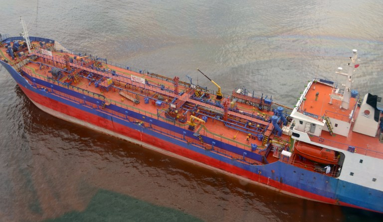 This handout photo taken on August 9, 2013 and released by the Philippine Coast Guard shows the oil tanker M/T MAKISIG off the shore of Cavite an oil spill in Manila Bay. ― AFP pic