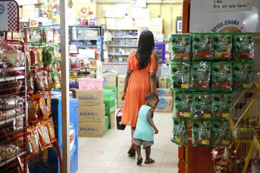 A foreign woman and her child seen in the convenience shop at Ridzuan Condominium.