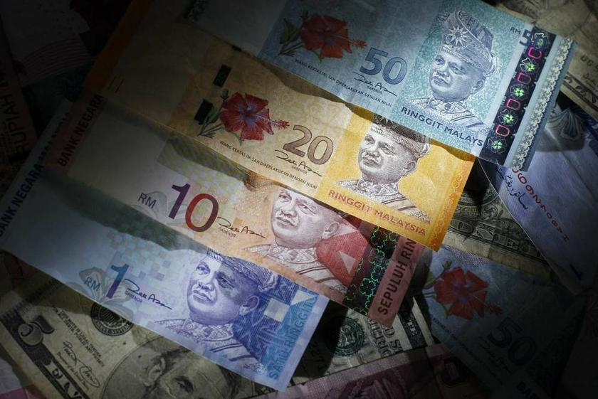 The ringgit extended yesterday's loss to open lower today. — Reuters pic
