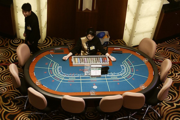 A high angle view of croupiers preparing to greet visitors at Sands Macau casino in Macau. Gambling revenues in Macau have fallen for the second month in a row as China's big spenders rein in overt shows of wealth. — Reuters pic