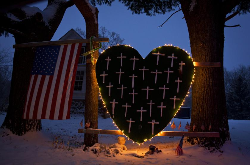 A heart that bears 26 crosses for each victim is surrounded by lights the Sandy Hook portion of Newtown, Connecticut December 14, 2013. ― Reuters pic