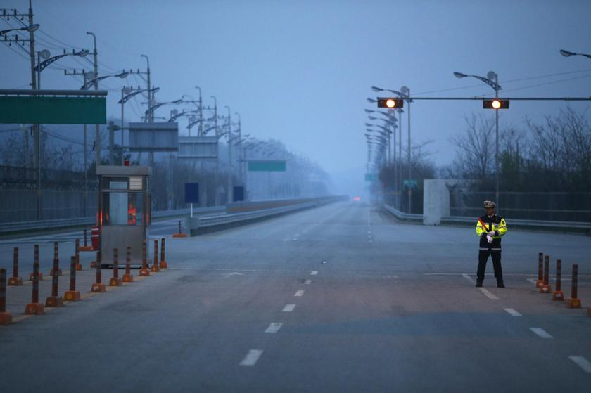 A South Korean police officer stands guard on an empty load connecting the Kaesong Industrial Complex inside the North Korean border with the South's CIQ, just south of the demilitarised zone separating the two Koreas, in Paju, north of Seoul May 3, 2013. — Reuters pic