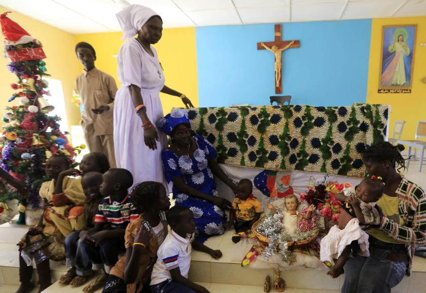 South Sudanese mothers living in the North attends a nativity play as part of Christmas celebrations at Catholic church in the Umbada locality of Omdurman, December 25, 2013. — Reuters pic