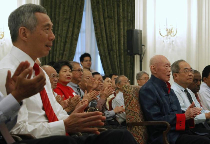 Guests applaud Lee Kuan Yew (third right) at the launch of One Man's View of the World at the Istana August 6, 2013. At left is Prime Minister Lee Hsien Loong. The 400-page book contained harsh words about Malaysia. — Reuters pic