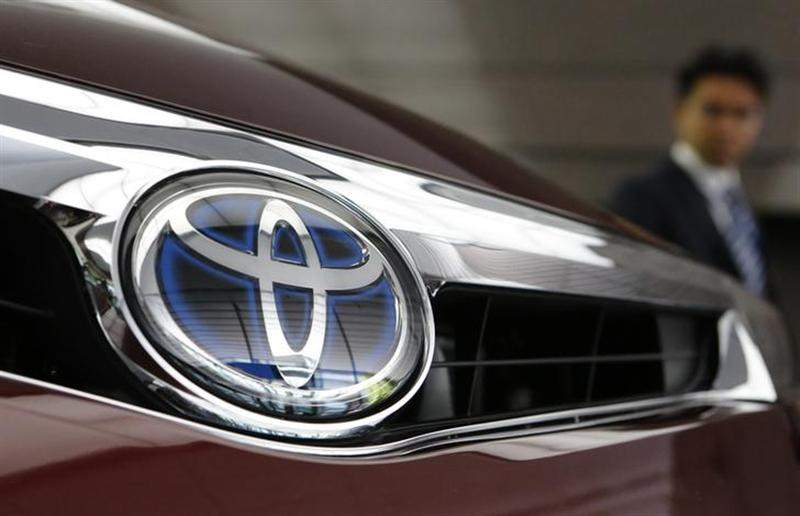 File photo of a visitor looking at a Toyota Motor car at the company's showroom in Tokyo on May 8, 2013. — Reuters pic
