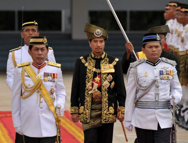 Tuanku Mizan Zainal Abidin inspects the royal guard of honour during a farewell ceremony at Parliament House in Kuala Lumpur in this file picture taken on December, 12 2011.. — AFP pic