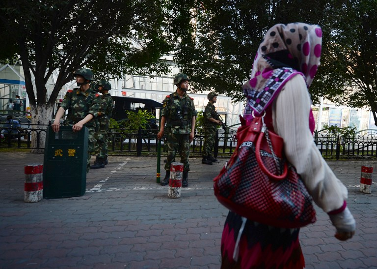 Chinese paramilitary police stand guard in the Muslim Uighur minority area of Urumqi, Xinjiang Province on June 30, 2013. ― AFP file pic