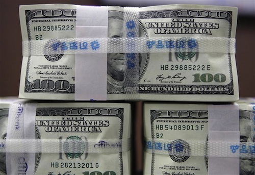 US 100-dollar bills are piled up after being counted at the Korea Exchange Bank (KEB) in Seoul October 13, 2008. — Reuters pic
