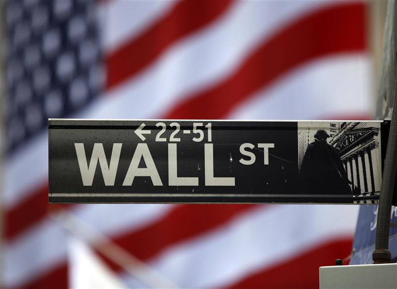 The Wall Street sign is seen outside the New York Stock Exchange, March 26, 2009. — Reuters pic