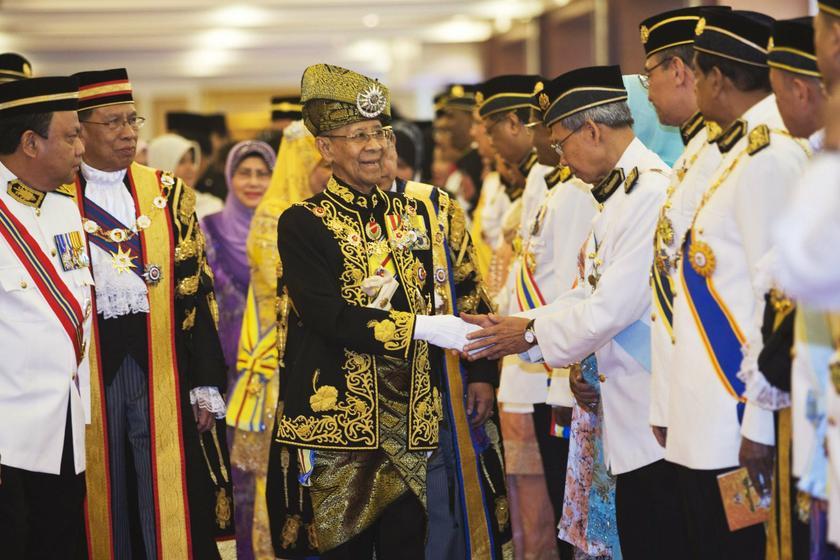 Yang di-Pertuan Agong Tuanku Abdul Halim Mu'adzam Shah greets MPs as he arrives for the opening of the Parliament sitting at Parliament House in Kuala Lumpur on June 25, 2013. — Reuters pic